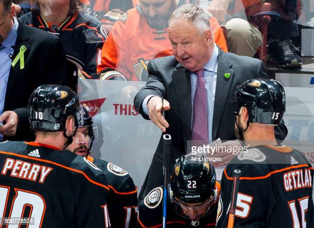 Head coach Randy Carlyle of the Anaheim Ducks gives direction to his players during the second period of the game against the New Jersey Devils at...