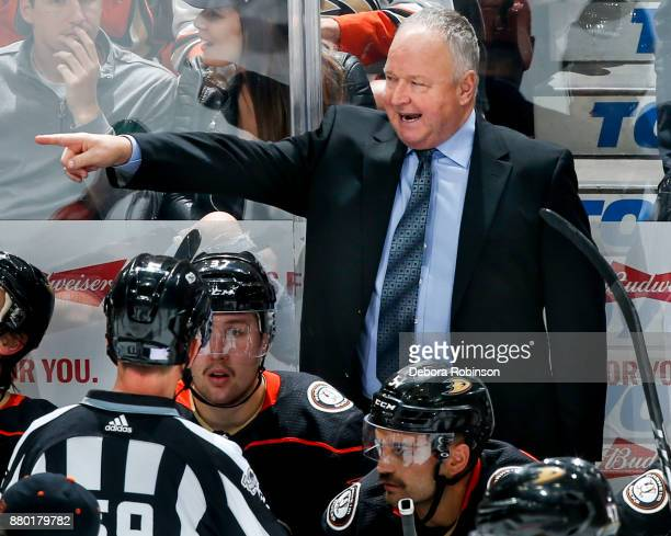 Head coach Randy Carlyle of the Anaheim Ducks talks with linesman Steve Barton during the second period of the game against the Vegas Golden Knights...