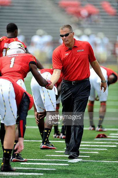 Head coach Randy Edsall of the Maryland Terrapins shakes hands with Stefon Diggs before the game against the William Mary Tribe at Byrd Stadium on...