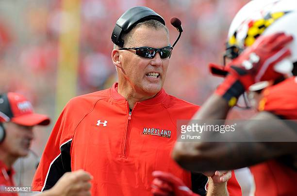 Head coach Randy Edsall of the Maryland Terrapins talks to his players during the game against the William Mary Tribe at Byrd Stadium on September 1...