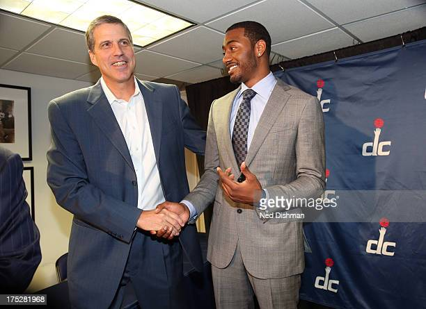 Head coach Randy Wittman and John Wall of the Washington Wizards share a moment during a press conference to announce a new contract at the Verizon...