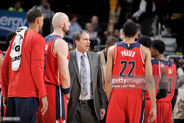 Head coach Randy Wittman of the Washington Wizards talks with his team during the game against the Cleveland Cavaliers on December 1 2015 at Quicken...
