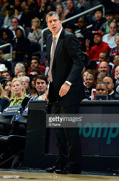 Head coach Randy Wittman of the Washington Wizards watches the game against the Miami Heat at the Verizon Center on December 1 2014 in Washington DC