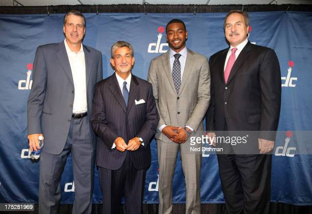 Head coach Randy Wittman team owner Ted Leonsis John Wall and general manager Ernie Grunfeld of the Washington Wizards pose for a photo during a...