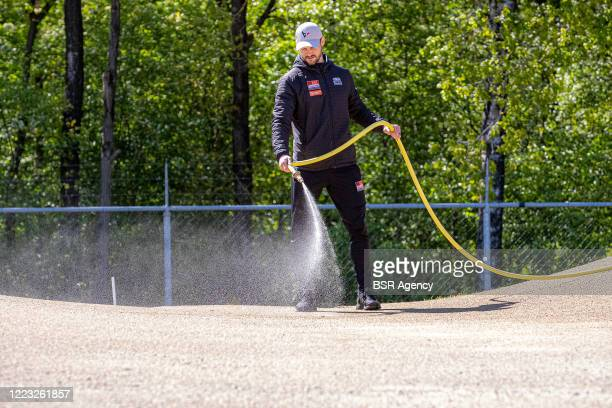 Head coach Raymon van der Biezen is spraying the track with water at the Dutch top BMX riders first training at Papendal training centre after the...