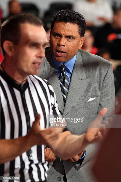 Head coach Reggie Theus of the CSUN Matadors reacts to official Daryl Gelinas in the second half of the home opening game against the Montana State...