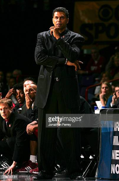 Head Coach Reggie Theus of the New Mexico State Aggies watches his team plays the Texas Longhorns during the first round of the NCAA Men's Basketball...