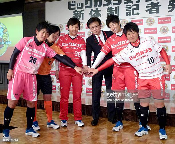 Head coach Reika Utsugi pitcher Yukiko Ueno and other palyers and staffs of Bic Camera Softball Club pose for photographs during a press conference...