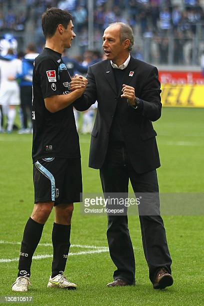 Head coach Reiner Maurer of Muenchen celebrates the 30 victory with Christoph Schindler after the Second Bundesliga match between MSV Duisburg and...