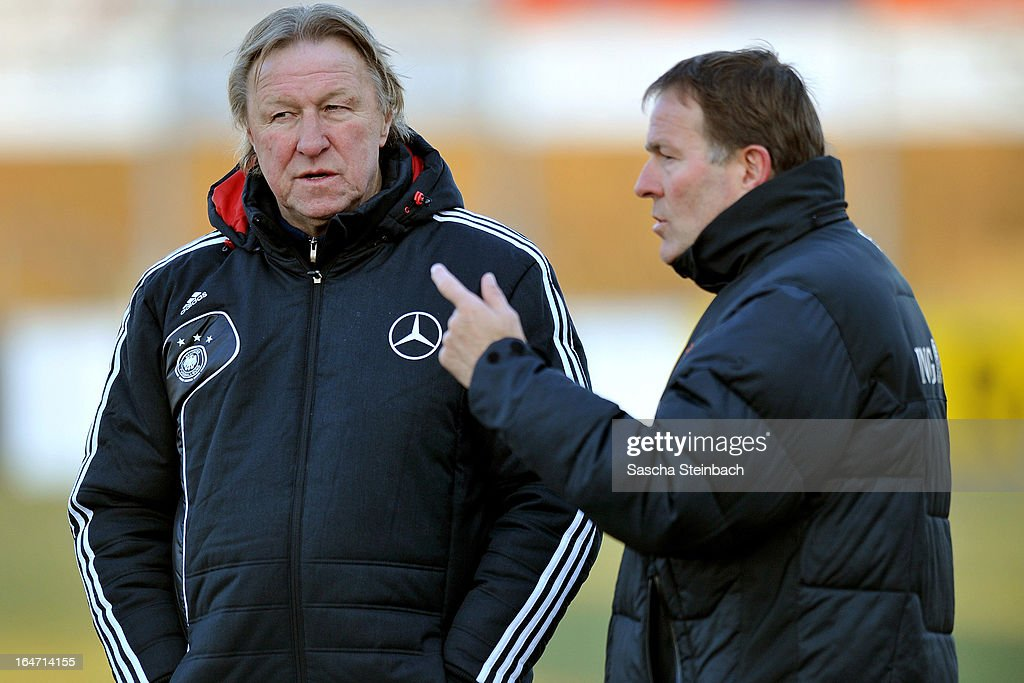 Head coach Remy Reijnierse from The Netherlands (R) talks to head coach Horst Hrubesch of Germany (L) prior to the U18 International Friendly match between The Netherlands and Germany on March 26, 2013 in Vriezenveen, Netherlands.