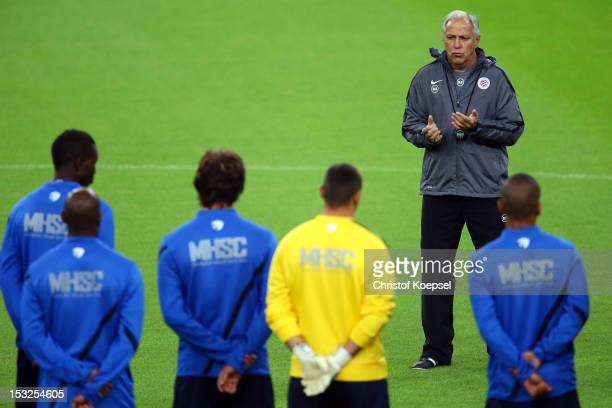 Head coach René Girard speaks to the team during the training session of Montpellier Herault SC at the VeltinsArena ahead of the UEFA Champions...