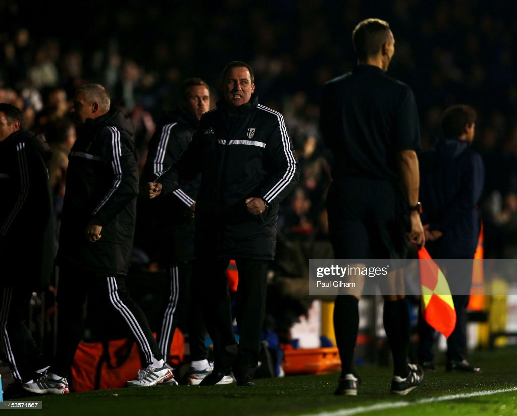 Head coach Rene Meulensteen of Fulham celebrates as Ashkan Dejagah (not pictured) scores their first goal during the Barclays Premier League match between Fulham and Tottenham Hotspur at Craven Cottage on December 4, 2013 in London, England.
