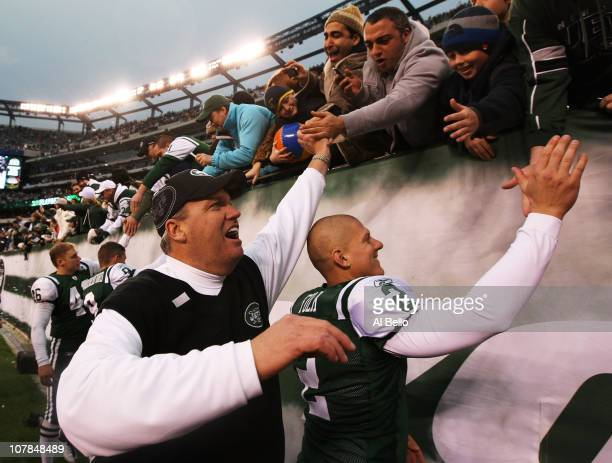 Head coach Rex Ryan and Nick Folk of the New York Jets celebrate with fans after they defeated the Buffalo Bills 38 to 7 at New Meadowlands Stadium...