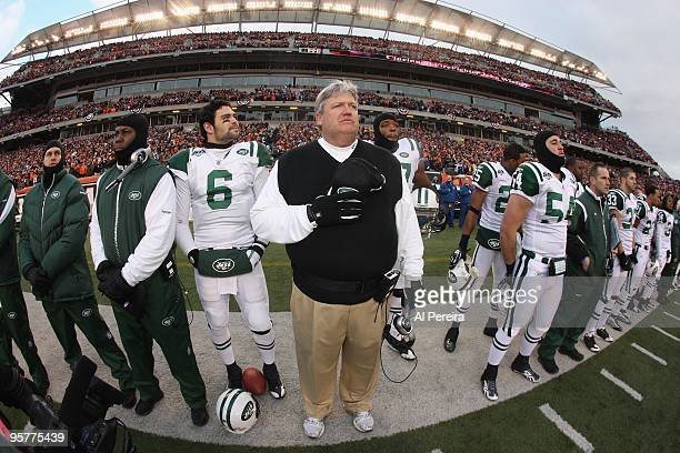 Head Coach Rex Ryan and Quarterback Mark Sanchez of the New York Jets stands at the line during the National Anthem before the game against the...