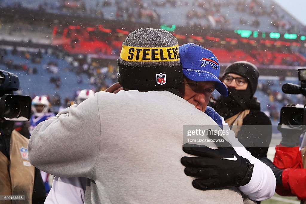 Head coach Rex Ryan of the Buffalo Bills and head coach Mike Tomlin of the Pittsburgh Steelers talk after the game at New Era Field on December 11, 2016 in Orchard Park, New York.