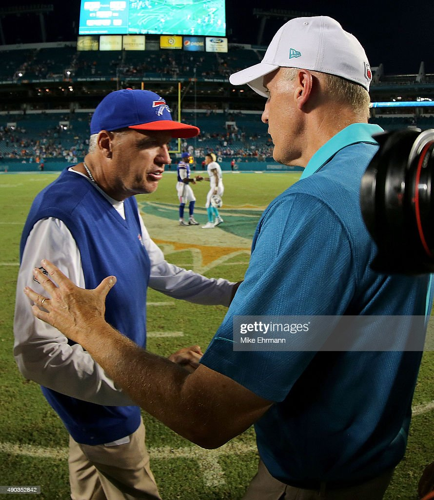 Head coach Rex Ryan of the Buffalo Bills shakes hands with head coach Joe Philbin of the Miami Dolphins during a game at Sun Life Stadium on September 27, 2015 in Miami Gardens, Florida.