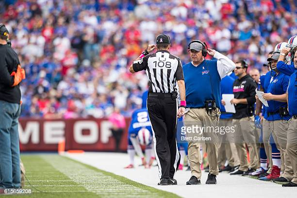 Head coach Rex Ryan of the Buffalo Bills speaks with line judge Gary Arthur during the first half against the San Francisco 49ers on October 16 2016...