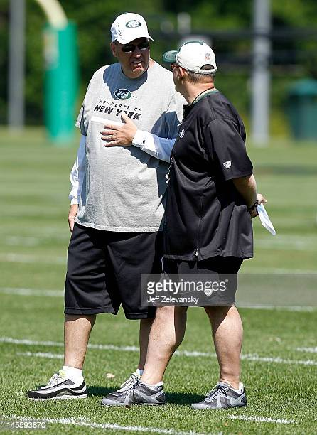 Head coach Rex Ryan of the New York Jets confers with offensive coordinator Tony Sparano at an organized team activity at the New York Jets practice...