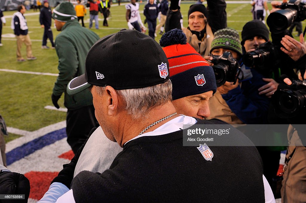 Head coach Rex Ryan of the New York Jets meets head coach Bill Belichick of the New England Patriots following a game at MetLife Stadium on December 21, 2014 in East Rutherford, New Jersey. The Patriots defeated the Jets 17-16.