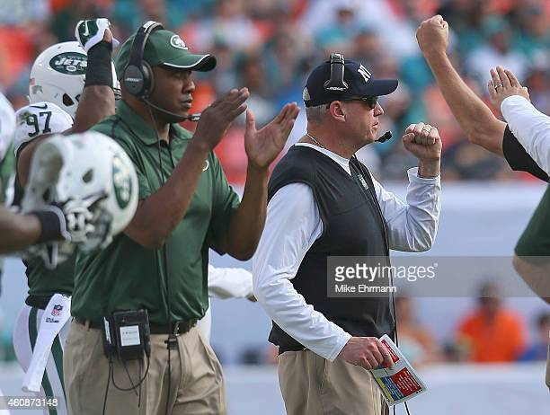 Head coach Rex Ryan of the New York Jets reacts after a defensive play on third down in the second quarter during a game against the Miami Dolphins...