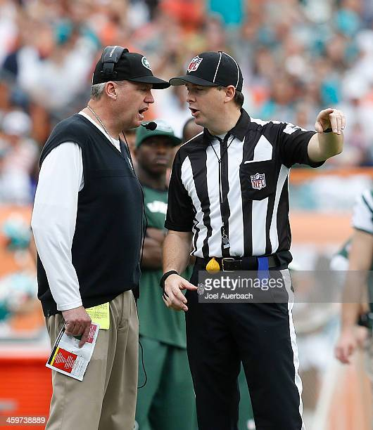 Head coach Rex Ryan of the New York Jets talks to side judge Allen Baynes during a break in action against the Miami Dolphins on December 29 2013 at...