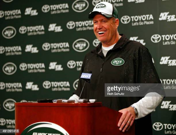 Head Coach Rex Ryan of the New York Jets talks with the media after their first day of rookie minicamp on May 16 2014 in Florham Park New Jersey