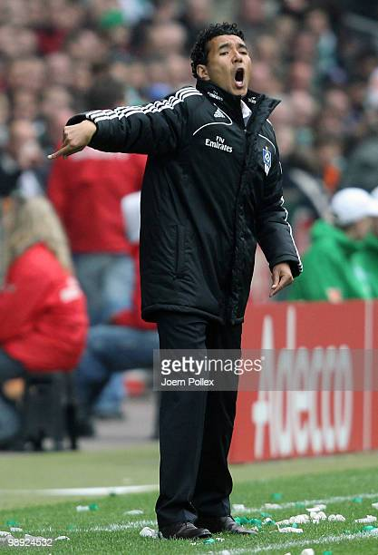 Head coach Ricardo Moniz of Hamburg gestures during the Bundesliga match between SV Werder Bremen and Hamburger SV at Weser Stadium on May 8 2010 in...
