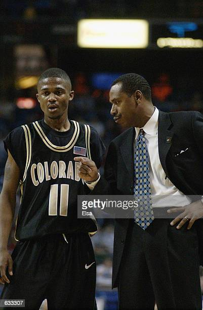 Head coach Ricardo Patton of the Colorado Buffaloes talks to James Wright during the Big XII Tournament game against the Nebraska Cornhuskers at...