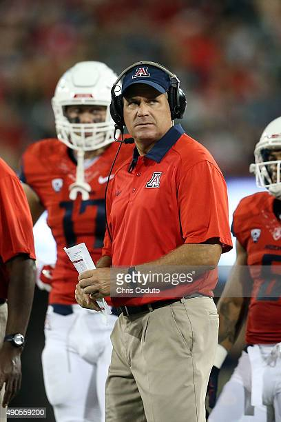 Head coach Rich Rodriguez looks on during the second half of the college football game against the Northern Arizona Lumberjacks at Arizona Stadium on...