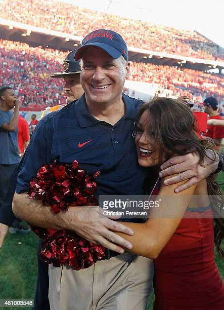 Head coach Rich Rodriguez of the Arizona Wildcats celebrates with daughter Raquel after defeating the Arizona State Sun Devils 4235 to win the PAC12...