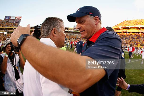 Head coach Rich Rodriguez of the Arizona Wildcats congratulates Todd Graham of the Arizona State Sun Devils following the college football game at...
