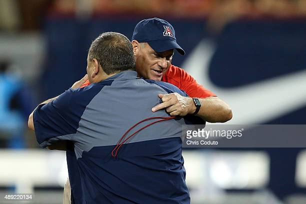 Head coach Rich Rodriguez of the Arizona Wildcats embraces head coach Jerome Souers of the Northern Arizona Lumberjacks before the college football...