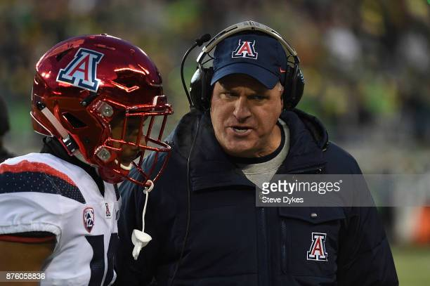 Head coach Rich Rodriguez of the Arizona Wildcats has some words with safety Scottie Young Jr #19 of the Arizona Wildcats during the first half of...