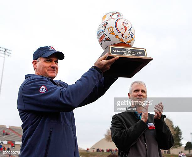 Head Coach Rich Rodriguez of the Arizona Wildcats holds up the Gildan Bowl Trophy at University Stadium on December 19, 2015 in Albuquerque, New...