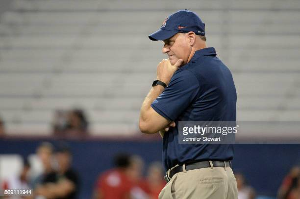 Head coach Rich Rodriguez of the Arizona Wildcats looks on during warm ups prior to the game against the Washington State Cougars at Arizona Stadium...