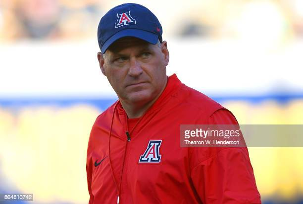 Head coach Rich Rodriguez of the Arizona Wildcats looks on while his team warms up prior to the start of an NCAA football game against the California...