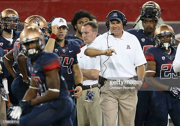 Head coach Rich Rodriguez of the Arizona Wildcats reacts on the sidelines during the college football game against the Northern Arizona Lumberjacks...