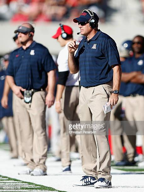 Head coach Rich Rodriguez of the Arizona Wildcats reacts on the sidelines during the college football game against the Washington Huskies at Arizona...