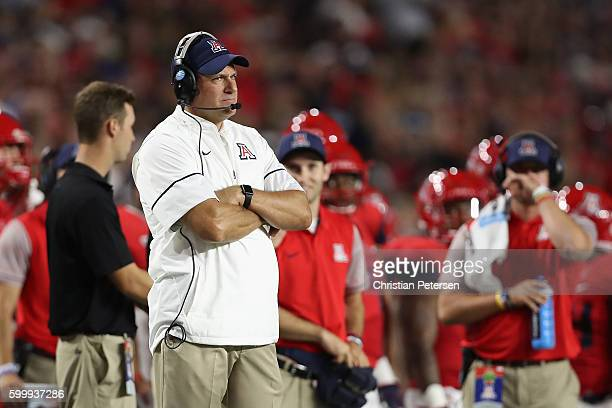 Head coach Rich Rodriguez of the Arizona Wildcats stands on the sidelines during the college football game against the Brigham Young Cougars at...