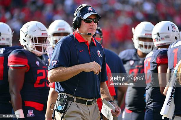 Head coach Rich Rodriguez of the Arizona Wildcats walks on the field in the college game against the Oregon State Beavers at Arizona Stadium on...