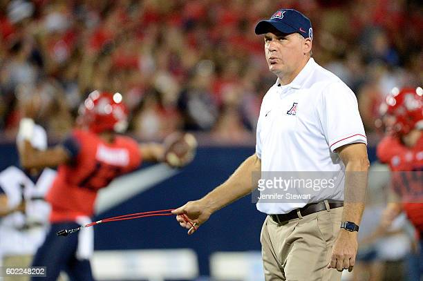 Head coach Rich Rodriguez of the Arizona Wildcats walks the field as his team warms up prior to the game against the Grambling State Tigers at...