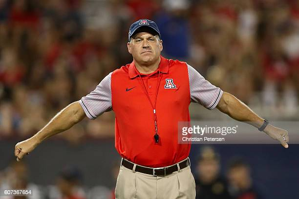 Head coach Rich Rodriguez of the Arizona Wildcats walks the field during warm ups to the college football game against the Hawaii Warriors at Arizona...
