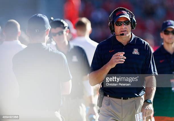 Head coach Rich Rodriguez of the Arizona Wildcats walks the sidelines during the college football game against the Washington Huskies at Arizona...