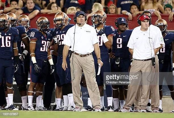 Head coach Rich Rodriguez of the Arizona Wildcats watches from the sidelines during the college football game against the Oregon State Beavers at...