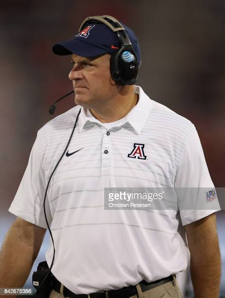 Head coach Rich Rodriguez of the Arizona Wildcats watches from the sidelines during the college football game against the Northern Arizona...