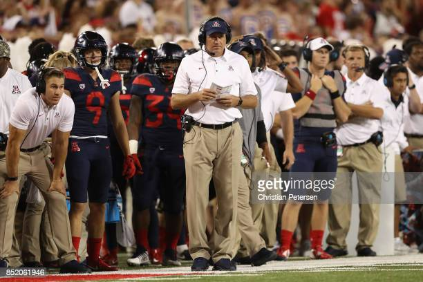 Head coach Rich Rodriguez of the Arizona Wildcats watches from the sidelines during the first half of the college football game against the Utah Utes...