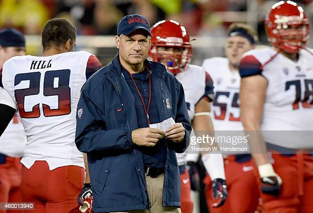 Head coach Rich Rodriguez of the Arizona Wildcats watches his team warm up prior to playing the Oregon Ducks in the Pac12 Championship game at Levi's...