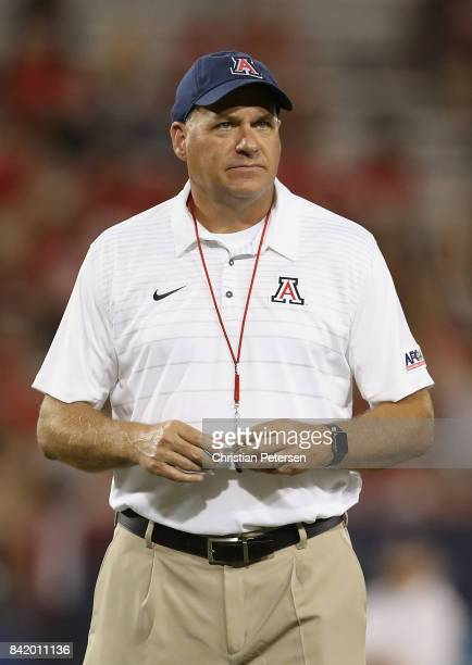 Head coach Rich Rodriguez of the Arizona Wildcats watches his team warm up before the college football game against the Northern Arizona Lumberjacks...