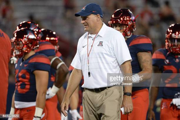 Head coach Rich Rodriguez of the Arizona Wildcats watches warm ups for the game against the Houston Cougars at Arizona Stadium on September 9, 2017...