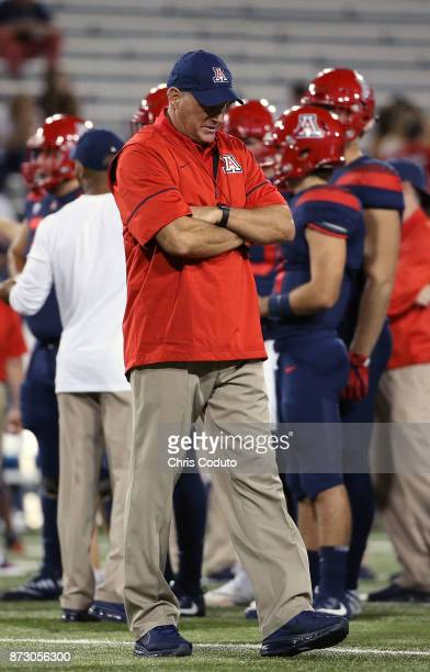 Head coach Rich Rodriguez of the Arizona Wildcats watches warm ups before the college football game against the Oregon State Beavers at Arizona...